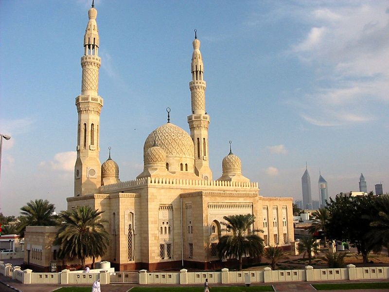 The uae s most famous mosque with the modern downtown in the